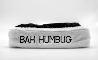 fur hat brim saying Bah Humbug in black and white isolated on a solid background