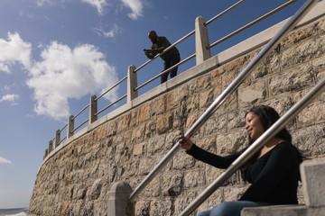 Woman taking selfie on promenade stairs