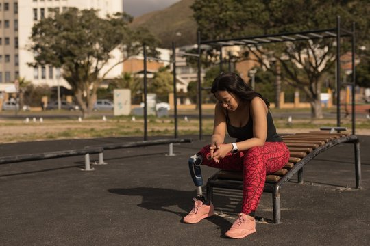 Disabled woman sitting on exercise bench