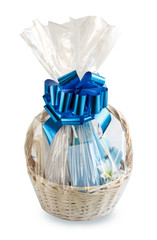 gift basket, hamper packed in transparent paper with a big blue bow isolated on a white background