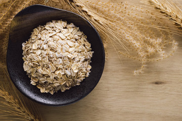 Bowl of Rolled Oats with Wheat and Grass