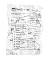 Crumpled tax form isolated on white.