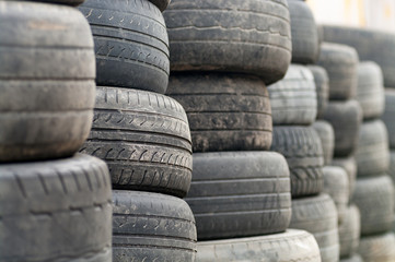 Used wheel tires stacked ready for recycling. Wall mural