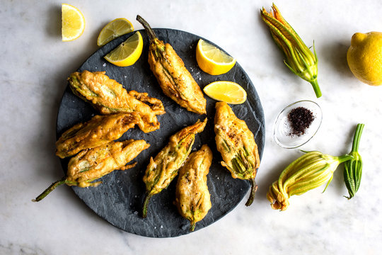 Close up of fried courgette flowers stuffed with goat cheese