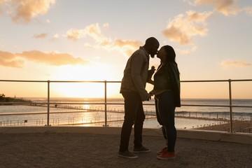 Couple kissing on promenade