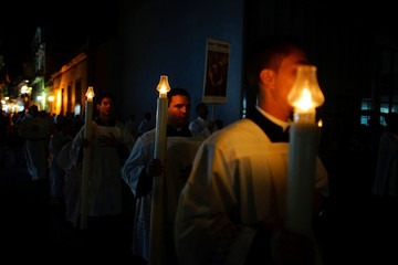 Members of the Catholic church take part in a procession to honour San Cristobal, patron Saint of Havana as part of the city's 499th anniversary celebrations in Havana