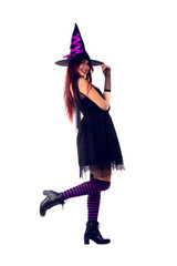 Photo of witch brunette in black dress and hat