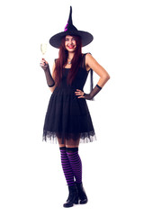 Photo of smiling witch with wine glass with wine in black dress and hat