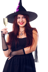 Picture of happy witch with wine glass with wine in black dress and hat