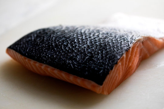 Close up of salmon fillet against white background