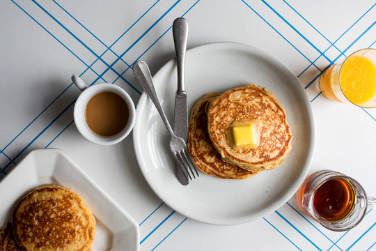 Overhead view of whole grain pancakes served with butter on plate
