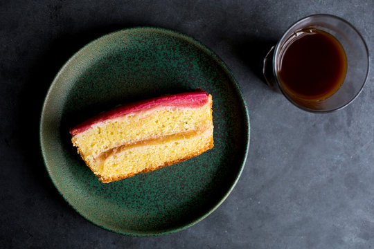 Overhead view of slice of rhubarb vanilla pound cake served on plate