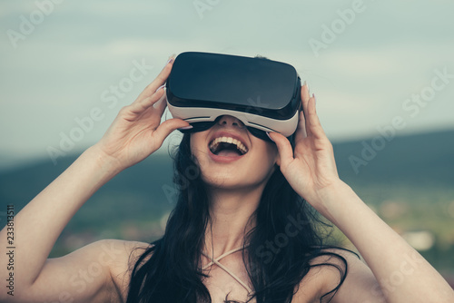 894e6a6f899a Woman getting experience using VR-headset glasses. Digital future and  innovation. Visual reality concept. Woman with glasses of virtual reality.