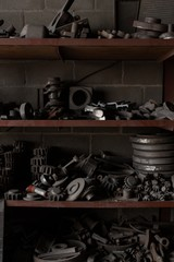 Unfinished metal castings arranged in rack