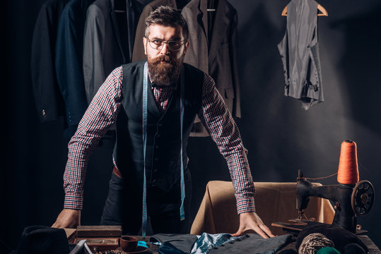 In search of inspiration. Bearded man tailor sewing jacket. business dress code. Handmade. retro and modern tailoring workshop. sewing mechanization. suit store and fashion showroom. In his own style