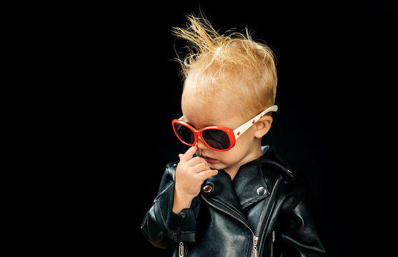 Rock and roll fashion trend. Little child boy in rocker jacket and sunglasses. Little rock star. Rock style child. Adorable small music fan. Music for children. Rock music is always rebellious