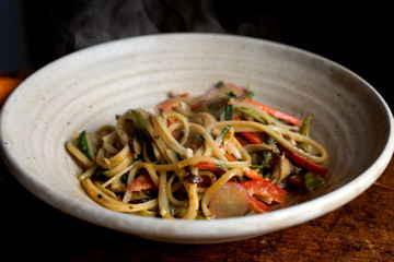 Close up of red curry noodles served in bowl