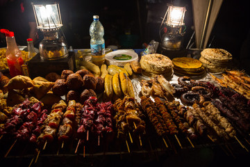 Zanzibari night street food market in Forodhani Gardens. Stone Town, Zanzibar City, Unguja island, Tanzania