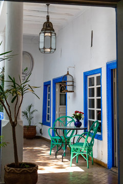 Patio with green chairs and blue framed windows
