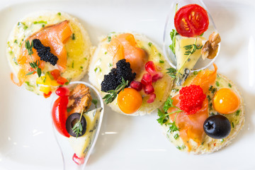 canape with fish, cheese and caviar
