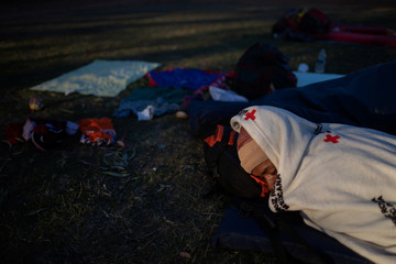 A migrant, part of a caravan of thousands trying to reach the U.S., sleeps at a shelter in Tijuana, Mexico