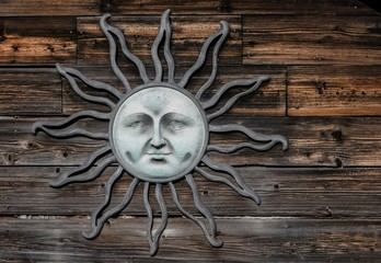 Sun Face medallion on the side of the old barn