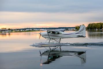 Float Pontoon Airplane Landing in a Lake in Anchorage Alaska