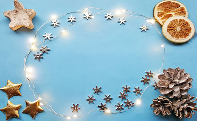 Christmas decorations on the blue background. View from the top. Free space for your text.