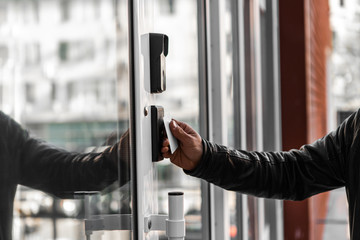 Security technologies, security systems, electronic keys, motion sensors. Hands open the door