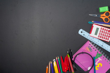 Education school tools on Black Chalkboard  Background