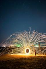 Steel wool fire on night beach, Thailand.