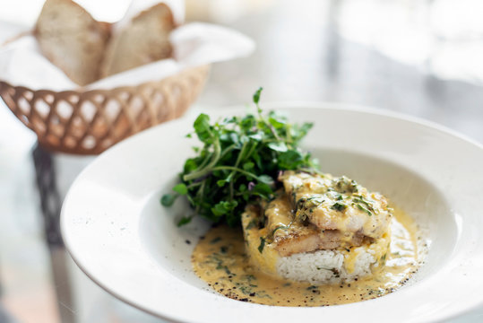 fish fillet in creamy mustard dill and lemon sauce meal