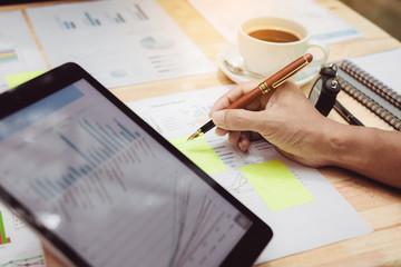 Entrepreneur doing finance graph in office room.