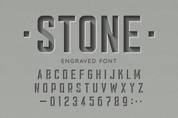 Engraved on stone font, alphabet letters and numbers