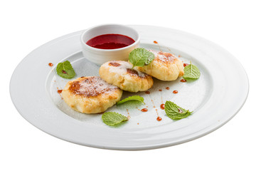 Cheesecakes. Cottage cheese pancakes with sour cream