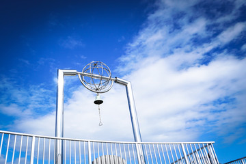 Bell with blue sky at cape Chikyu