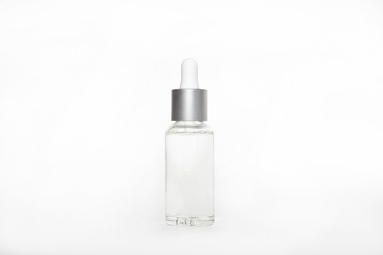blank mock up advertising with copy space of the dropper bottle isolated on the white background (flacon with pipette).