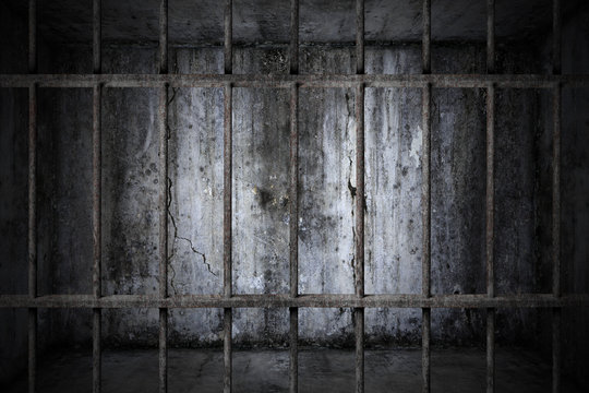 Old prison rusted metal bars cell lock with dark and bright in the jail