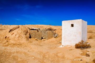 White building in Sahara desert, Tunisia, North Africa
