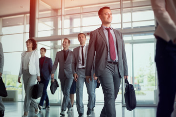 successful business people on the way in office building..