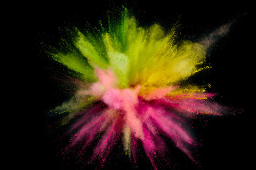 Colored powder explosion. Abstract closeup dust on backdrop. Colorful explode. Paint holi