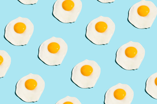 Fried eggs pattern on blue background