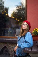 Summer sunny lifestyle fashion portrait of young stylish hipster woman walking on street,wearing cute trendy outfit with red hat ,smiling enjoy weekends.