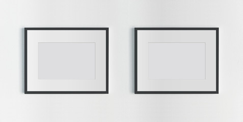 Two black frames hanging on a white wall mockup