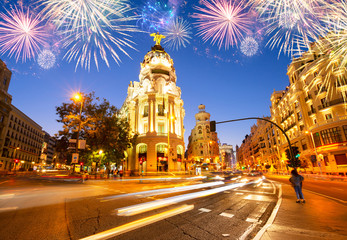 night cityscape at Calle de Alcala and Gran Via with fireworks, Madrid, Spain
