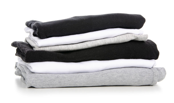 A stack of t-shirt gray black white on a white background. Isolation