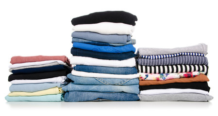 A stack of clothes jeans t-shirt shirt on a white background. Isolation Wall mural