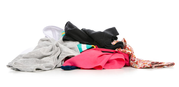 A pile of clothes on a white background. Isolation