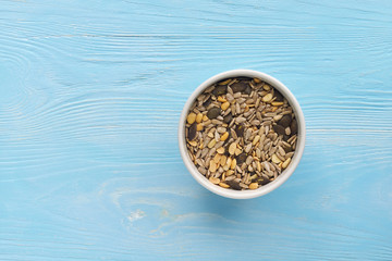 Breakfast seeds on light blue wooden table