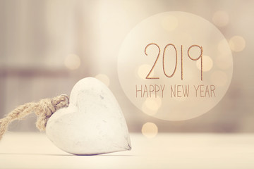 New Year 2019 message with a white heart  in a room
